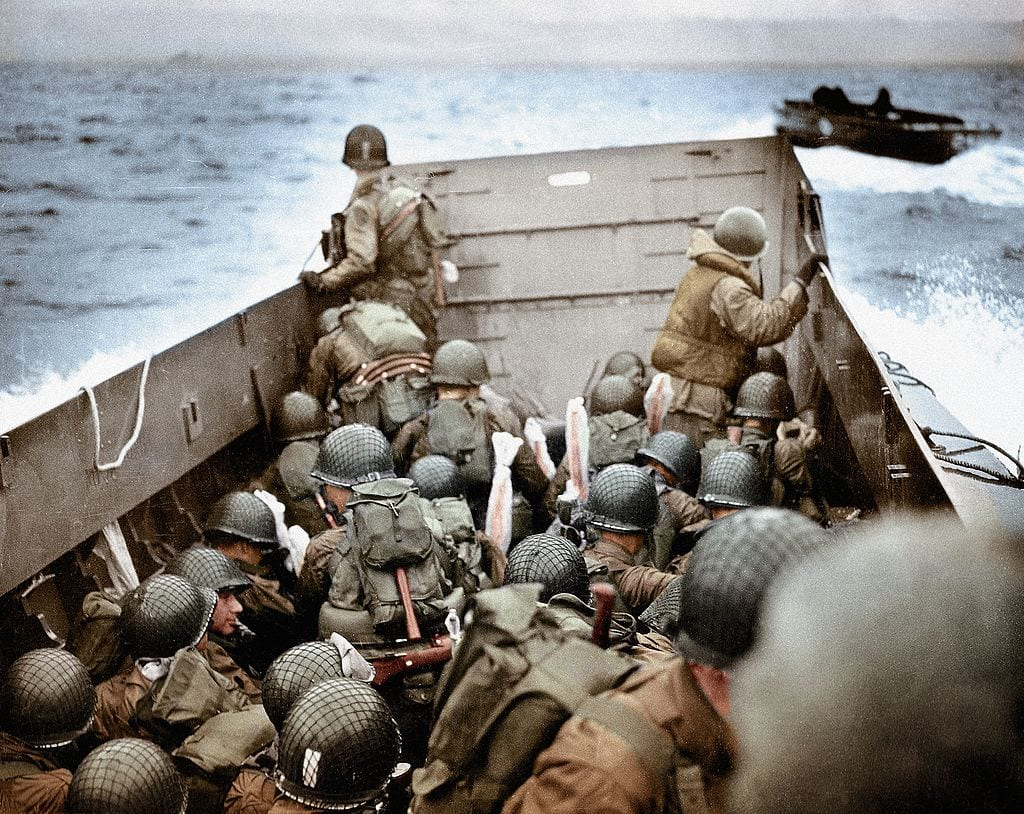 soldiers on their way to omaha beach