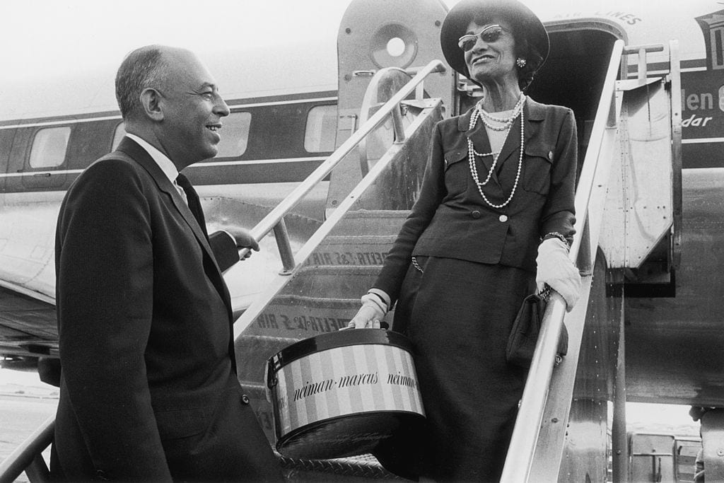 coco chanel descending from an airplane