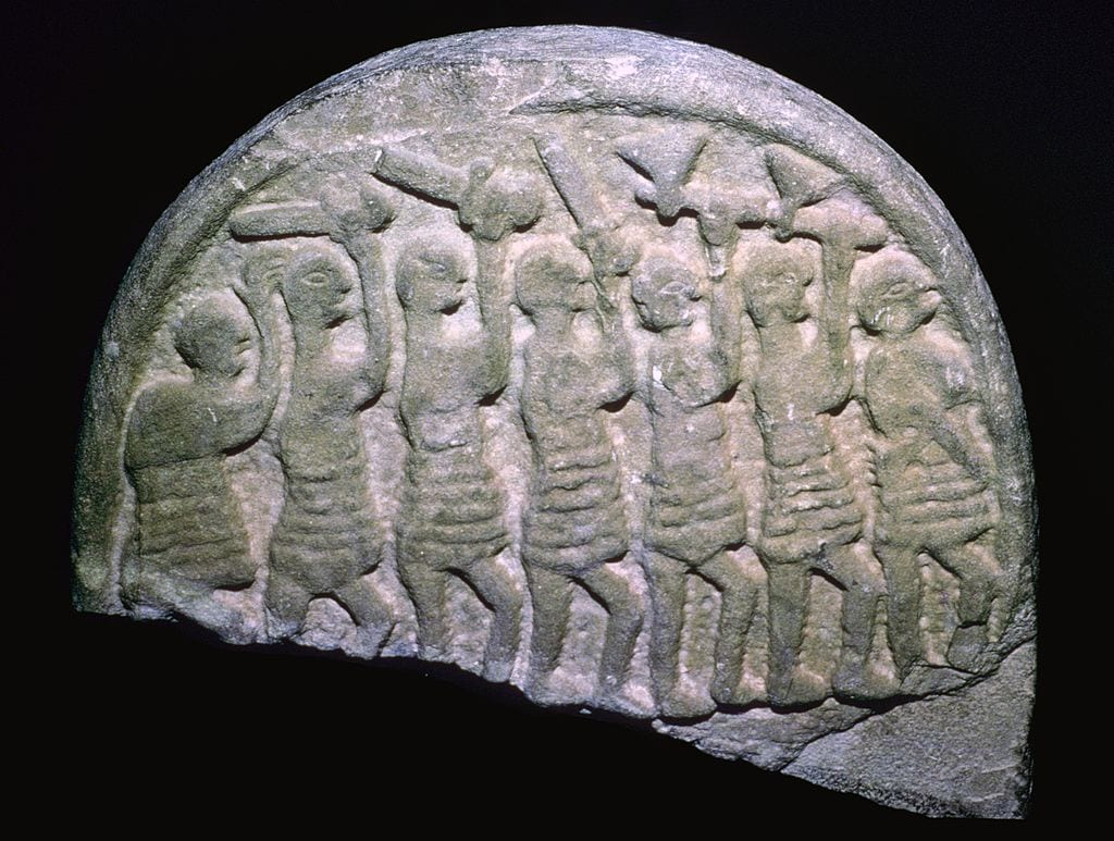 The Lindisfarne Stone showing warriors who may be vikings, Holy Island, Northumbria.
