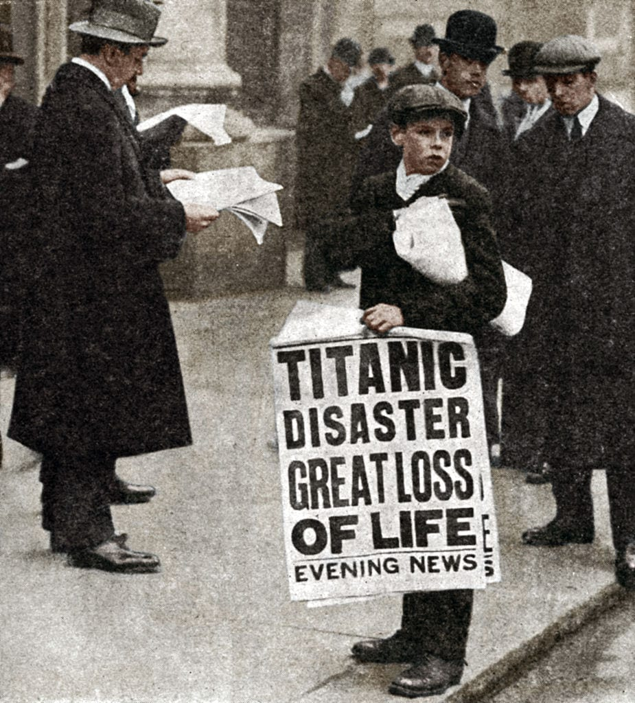 Newspaper boy with news of the Titanic disaster