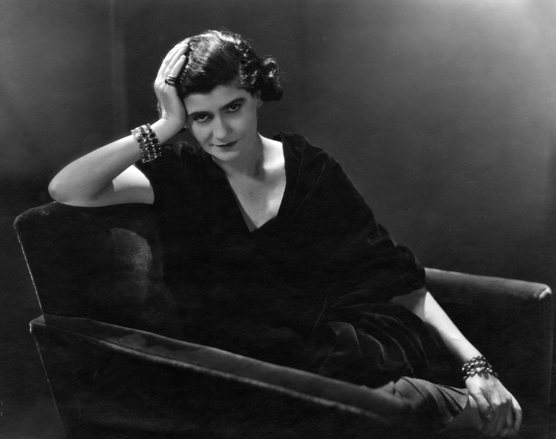 Gabrielle Chanel lounging on a couch