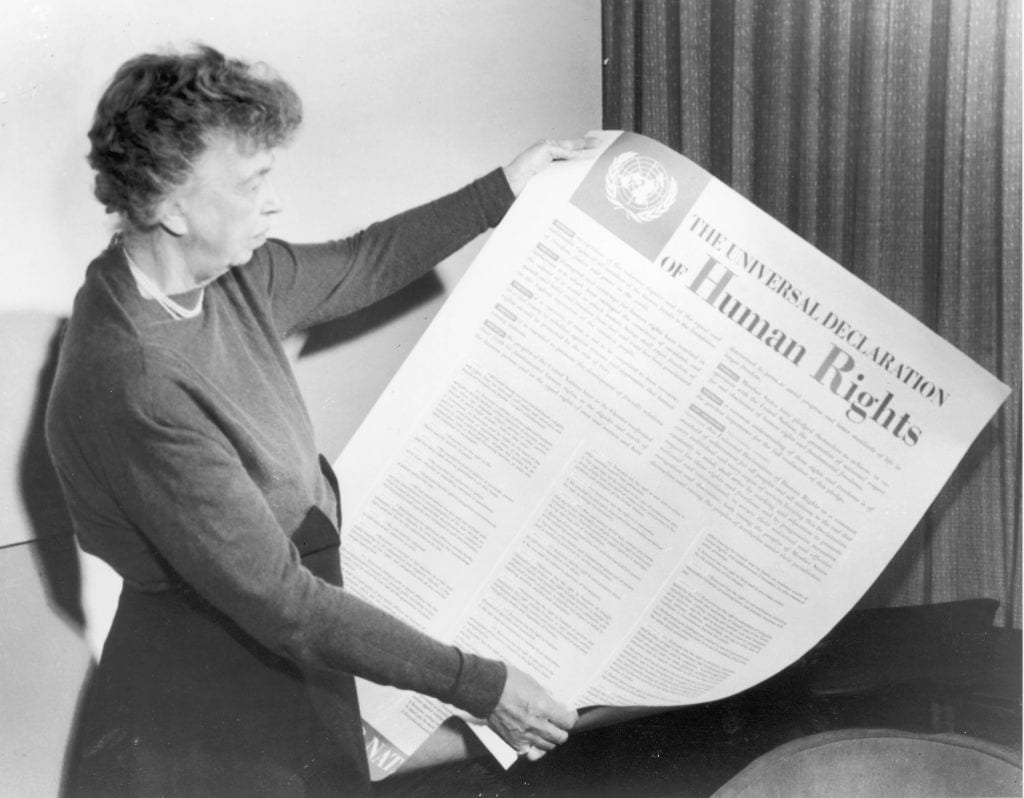 Eleanor Roosevelt holding up newspaper