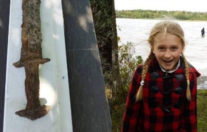 Eight-year-old girl casually discovers ancient Viking sword in lake