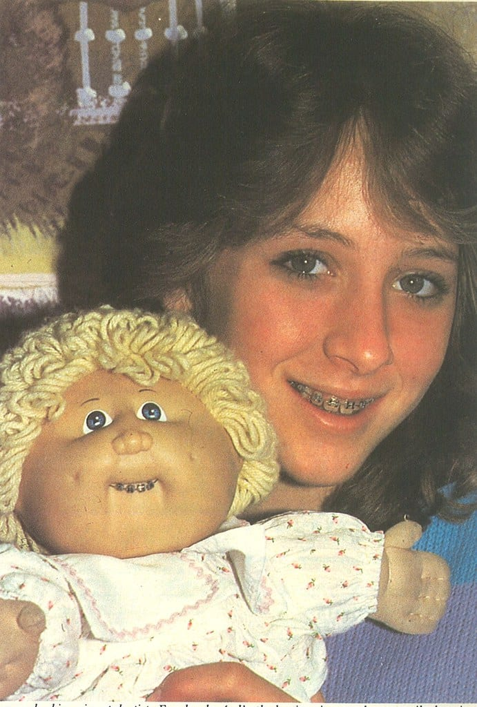Girl with cabbage patch kids