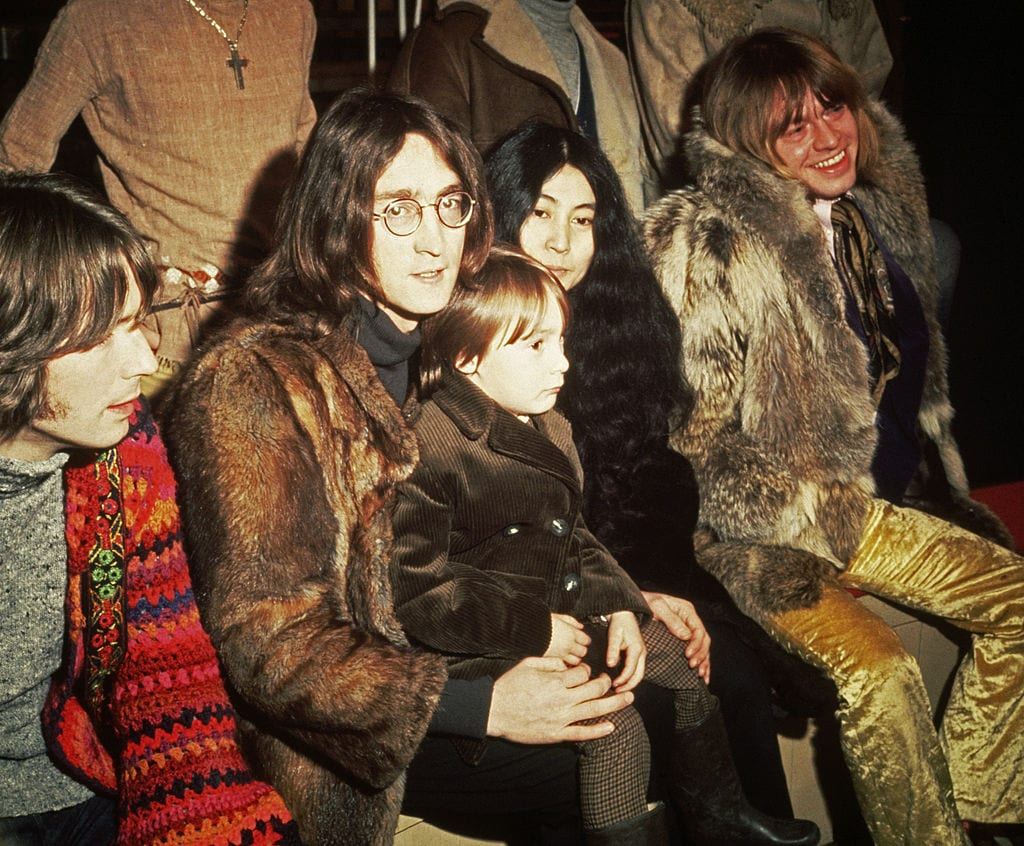 John Lennon with his son and wife