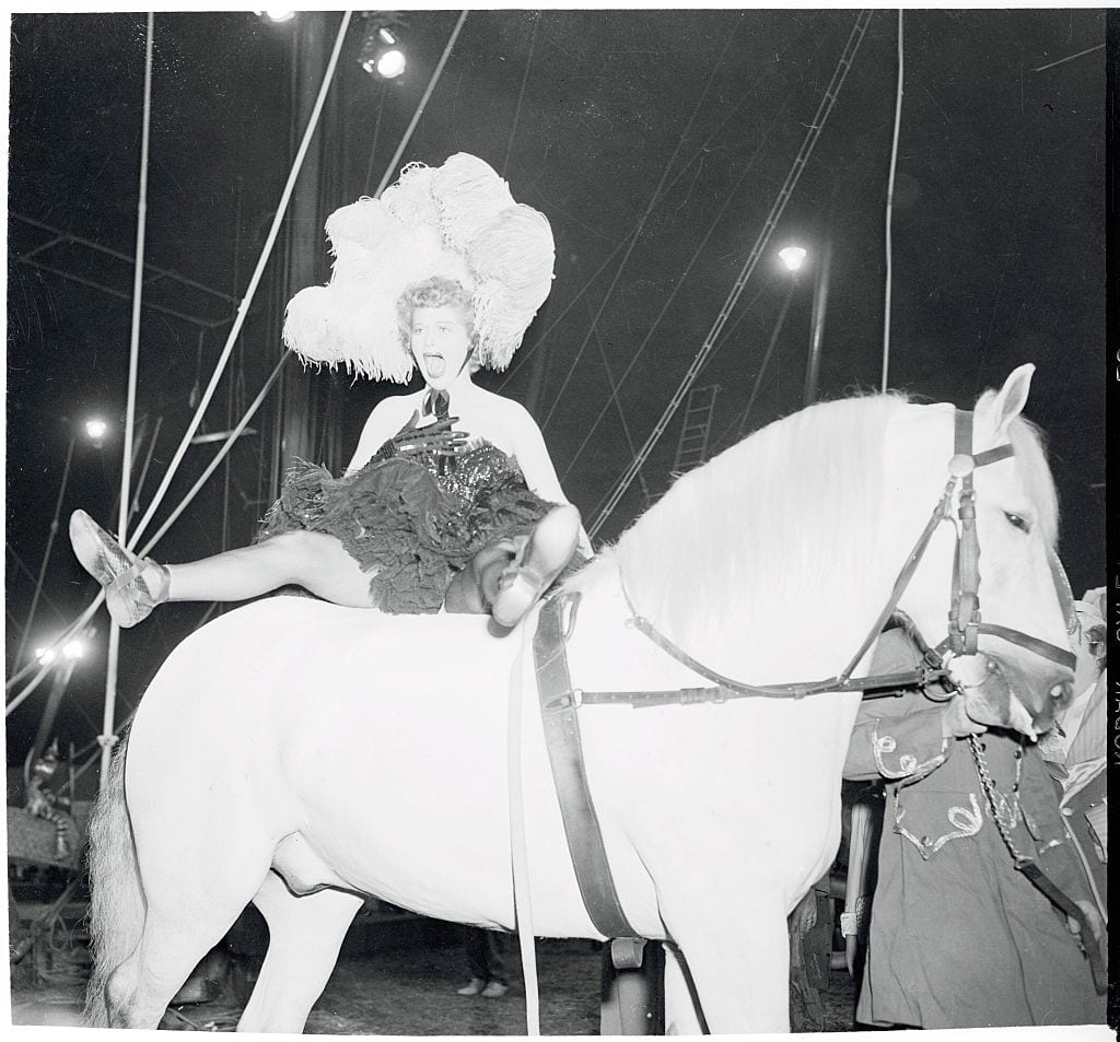 Actress Lucille Ball Yelling as She Bounces on Horse's Back