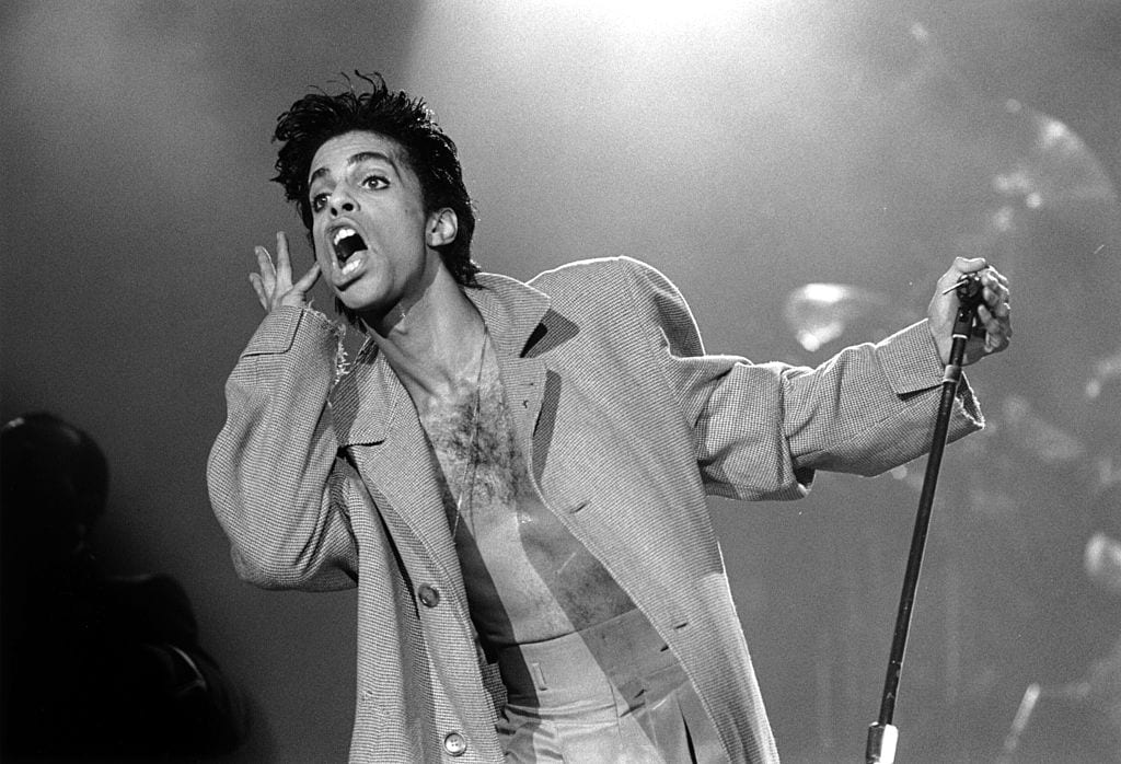 Prince singing on stage in the 1980s