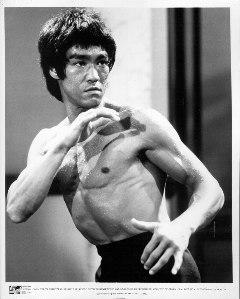 Bruce Lee holding a striking pose
