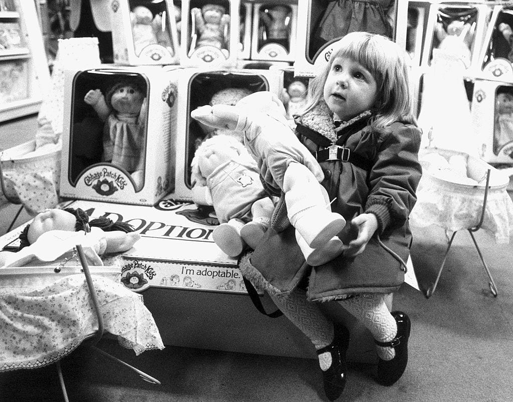Little girl with a Cabbage Patch Kid, December 1983