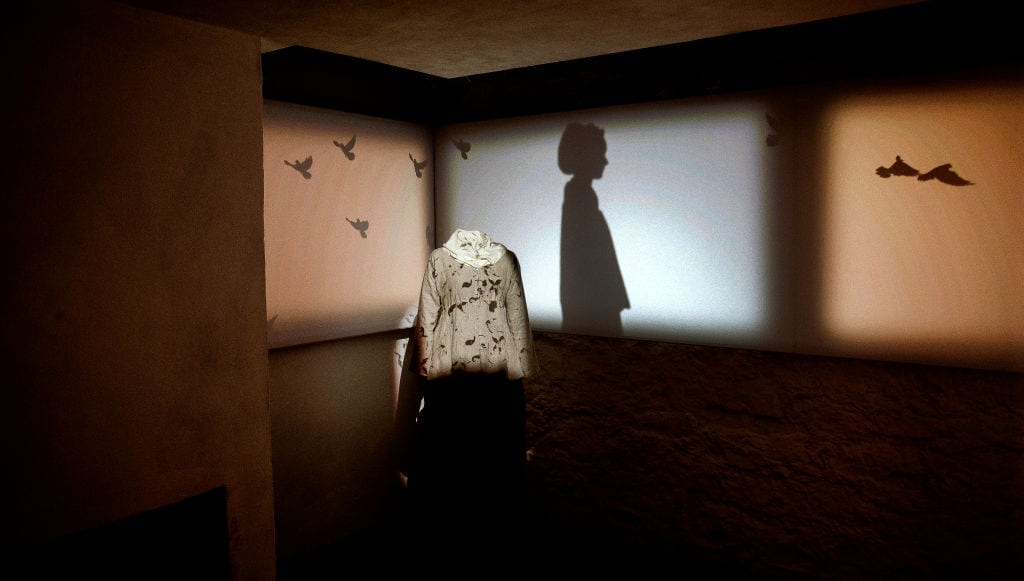 Hemings exhibition with shadow puppetry and a dress