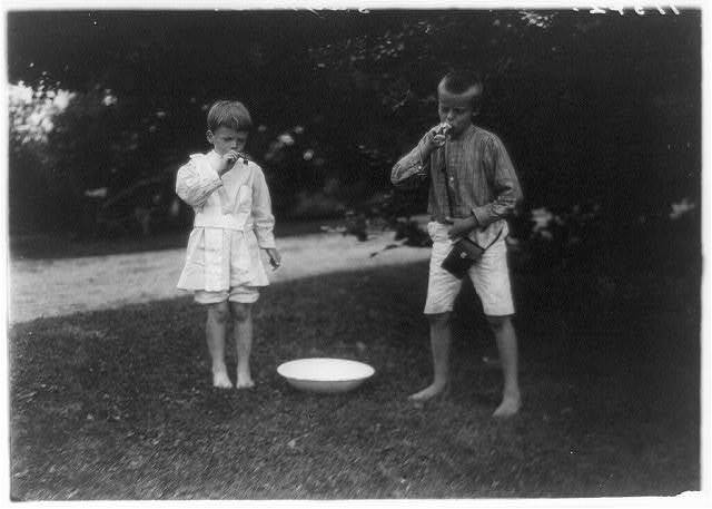 vintage kids, black and white photo, blowing bubbles, roosevelt kids, having fun