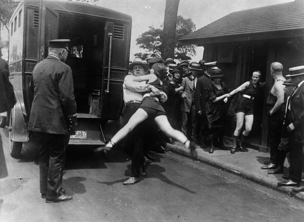 flapper arrested for wearing bathing suit, woman being arrested in 1922