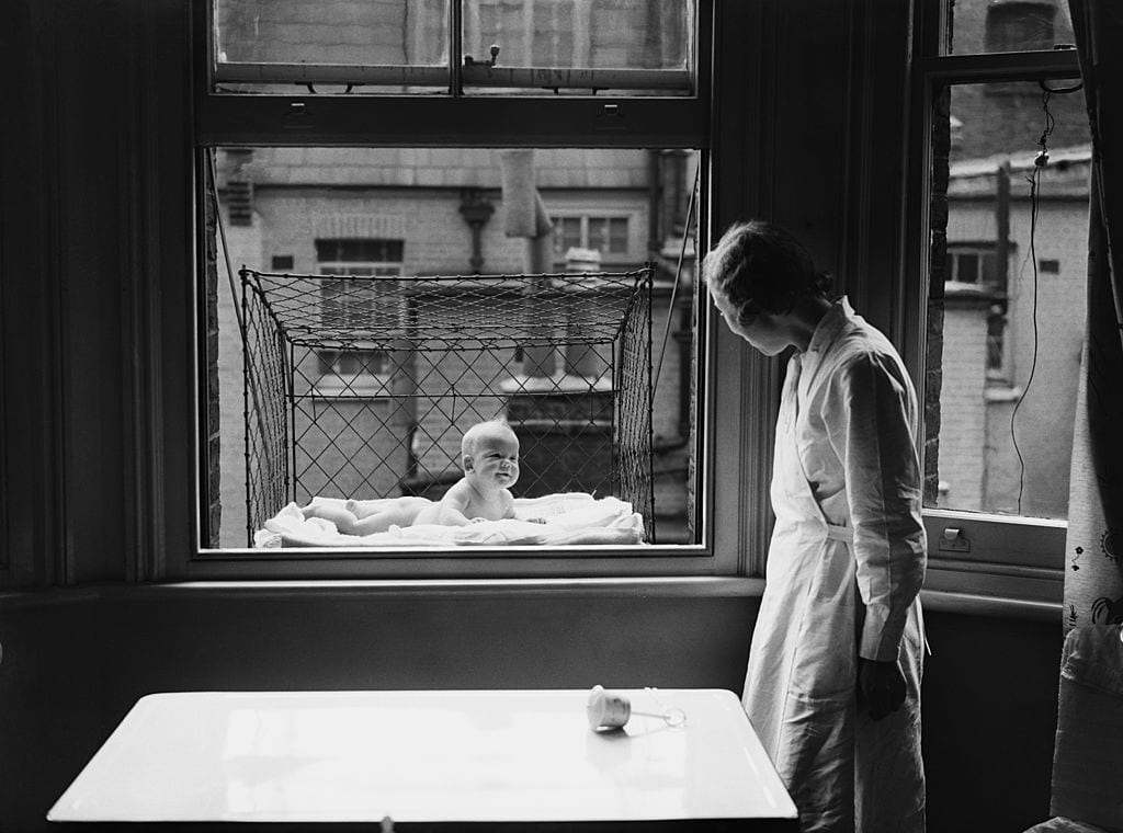 Baby suspended in a cage, shocking vintage photos