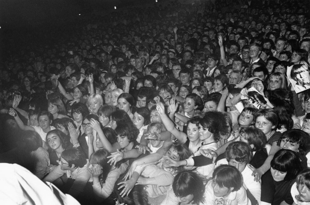 Fans at a rolling stones concert, crazy concert fans in the 1960s