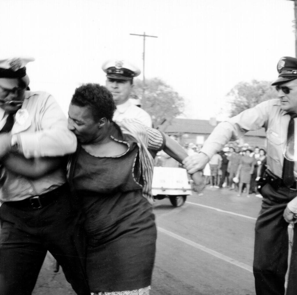 woman bites police officer, civil rights movement