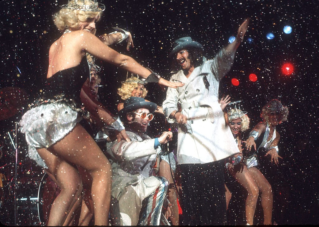 Elton dancing on stage with confetti
