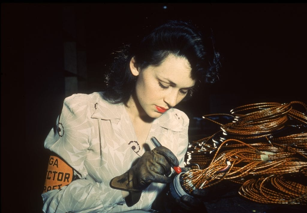 Rosie the Riveter, woman working in the electrical assembly