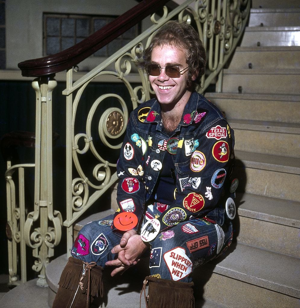 Elton John wearing patch jacket