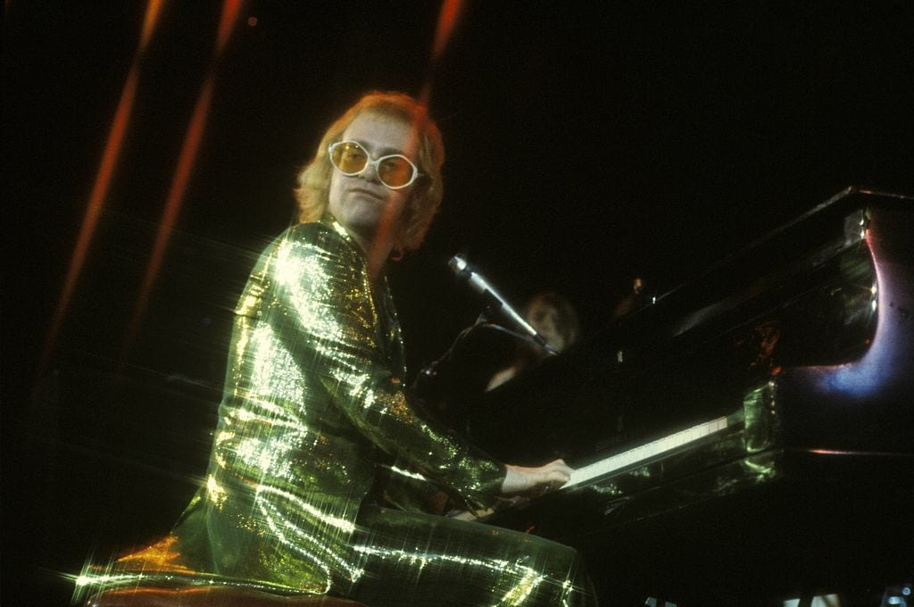 Elton John playing his piano