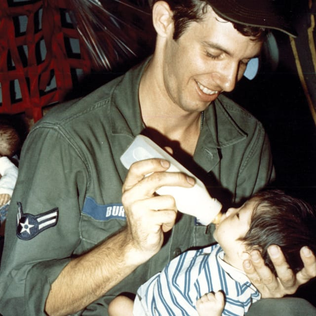Military officer feeds orphan baby