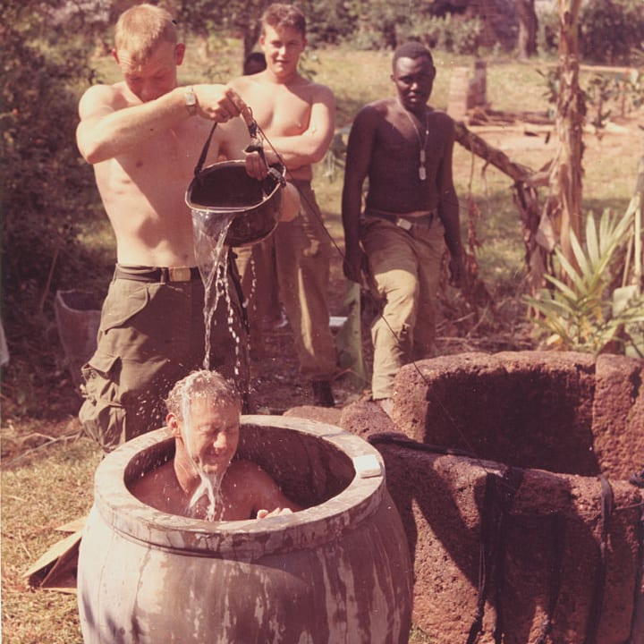 Members of the 1st Cavalry Division (Airmobile) enjoy a fresh water bath during a lull in operations in Phu My Province, South Vietnam