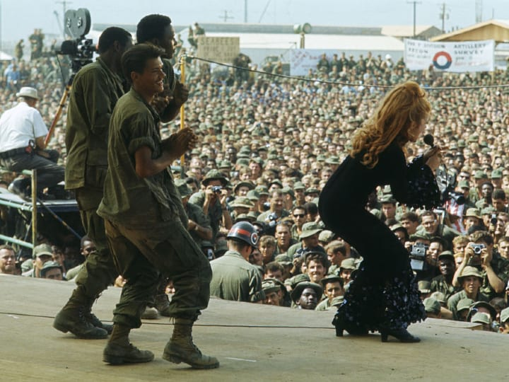 Ann-Margaret entertains the troops in Vietnam with a song and dance at the 9th Infantry Division Headquarters during Bob Hopes annual Christmas show.