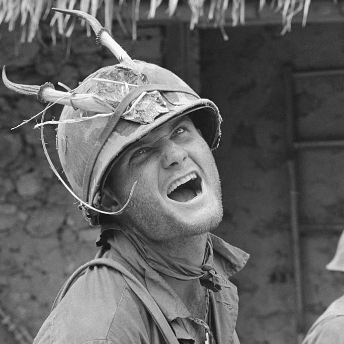 "Ham. Chu Lai, South Vietnam: With his stubble of beard, horned helmet and acting ability, this member of a Co. 2/502 101st Airborne Division, looks very much like a goat of sorts. The happy soldier and his colleagues were involved in ""Operation Wheeler,"" 30 miles North of Chu Lai."