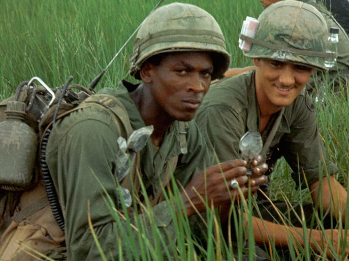 A patrol of US soldiers from the 9th Division in a leech infested rice paddy field in the Tan An Delta, Vietnam 1968.