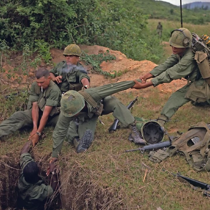 Vietnam War 1968. American soldiers uncover a Vietcong tunnel.