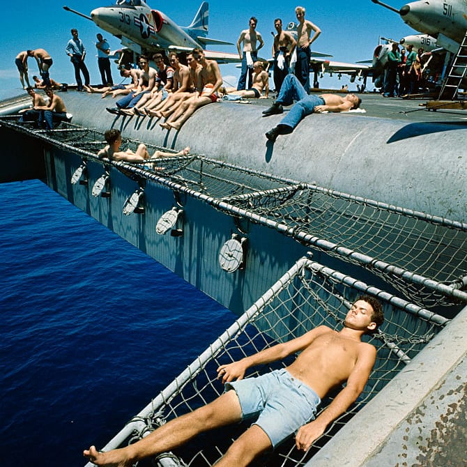 5,000 U.S.S. Constellation aircraft carrier crew members on a Sunday afternoon picnic on board while cruising in the Gulf of Tonkin off the coast of North Vietnam.