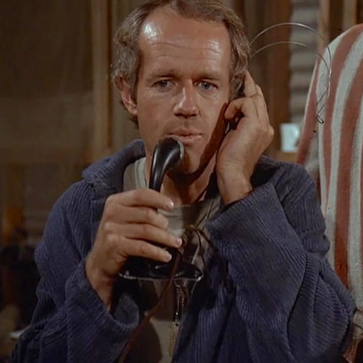 Mike Farrell, actor, talking on the phone