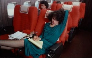 vintage-air-travel-stewardess-flight-attendant-glamorous-in-flight-travel-reclining-relaxing-stretching-leg-room