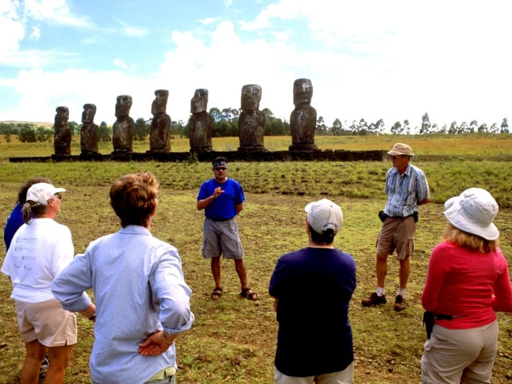 Easter Island, Ahu Akivi Platform For Tapati Festival Rapa Nui, Tourists And Guide.