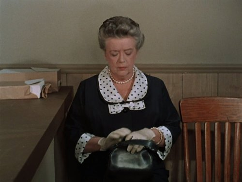 Aunt Bee, looking displeased, not happy