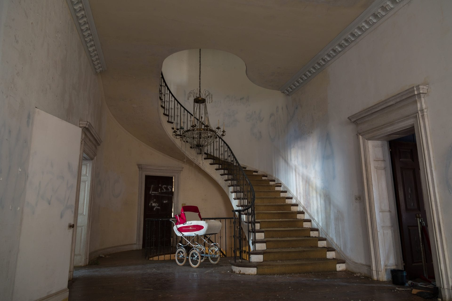 57-room-mansion-New-York-City-spiral-staircase-baby-carriage