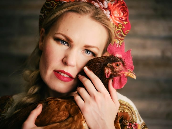 Russia woman with chicken