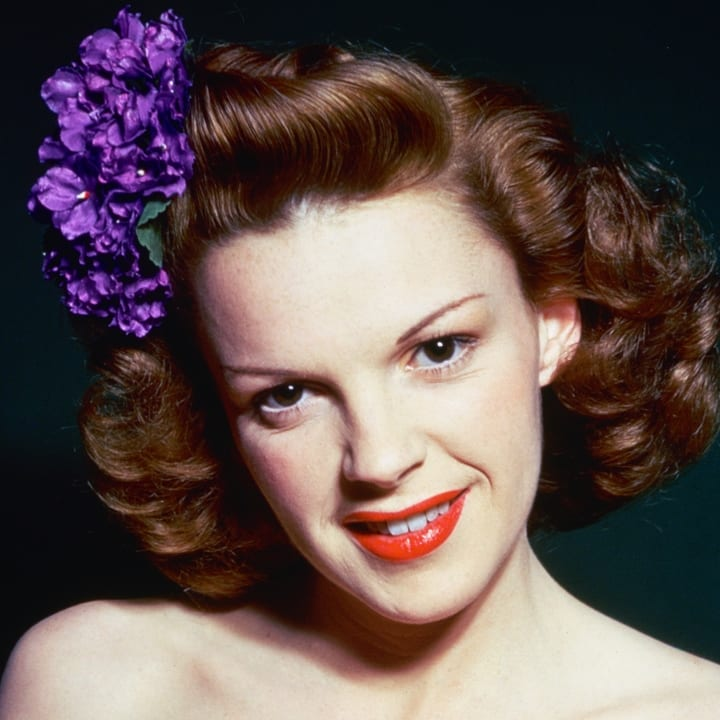 Judy Garland wearing purple flowers