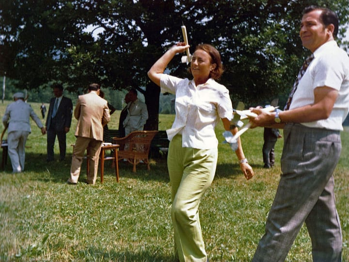 Couple playing with lawn darts