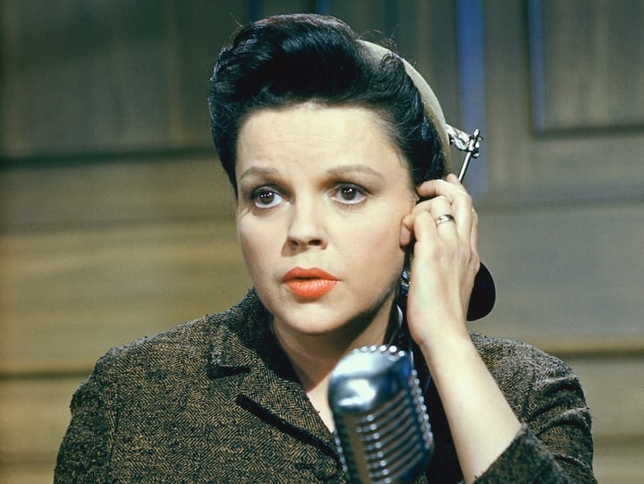Judy Garland in front of mic