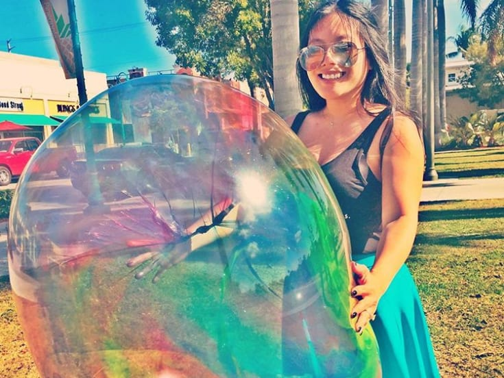 girl with giant plastic bubble