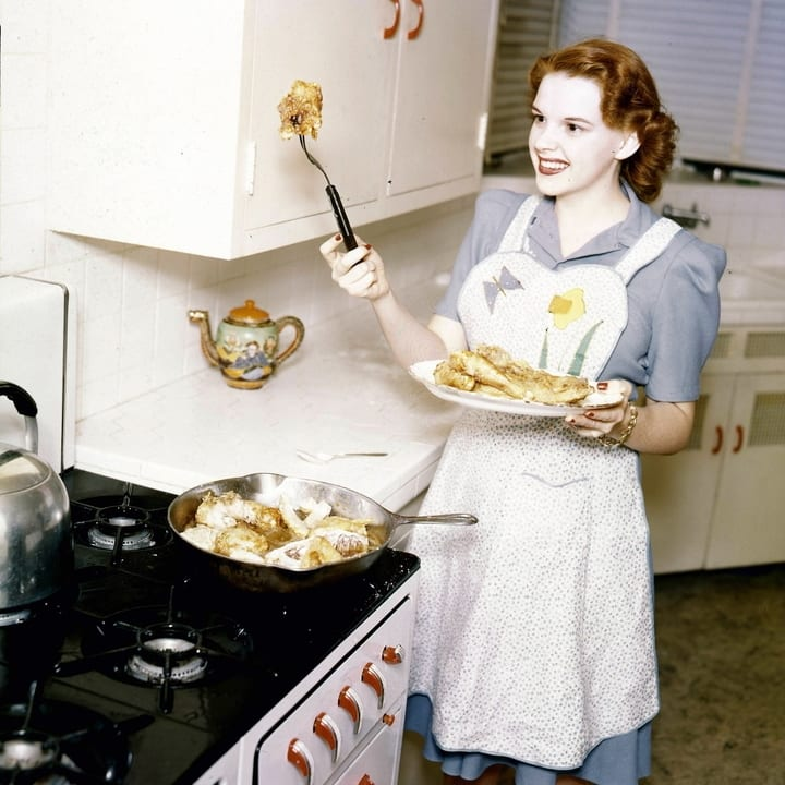 Judy Garland cooking in her kitchen