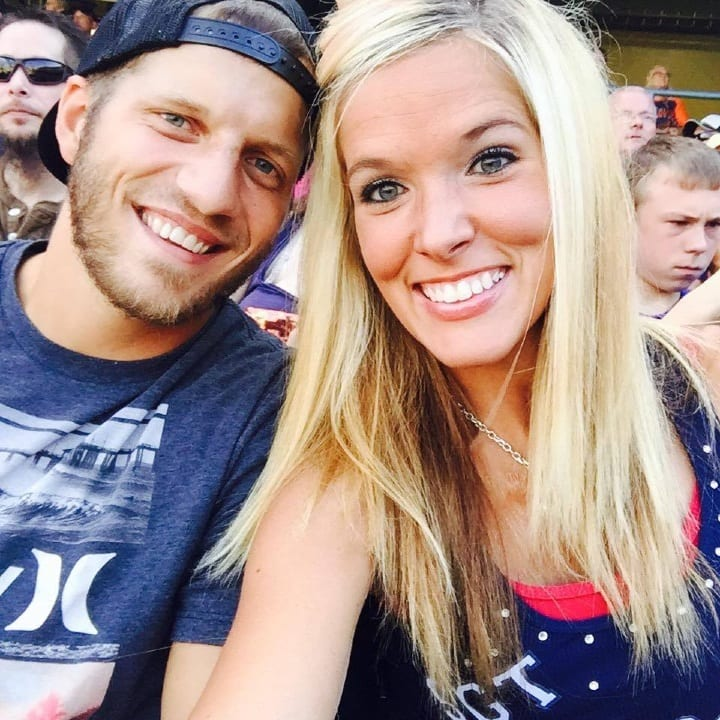 couple at a ball game, in the bleachers