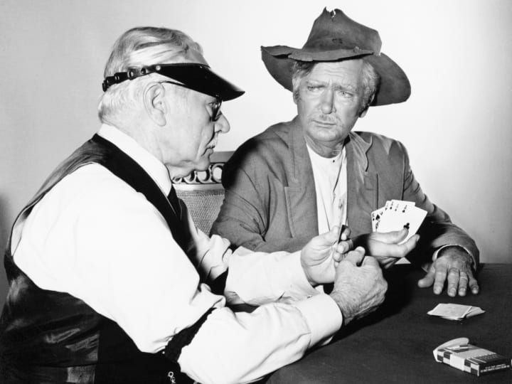 """A scene from the popular American TV series, The Beverly Hillbillies (1962-1971), featuring a cardgame between Buddy Ebsen and Charles Ruggles in the episode, """"Mrs. Drysdale's Father."""""""