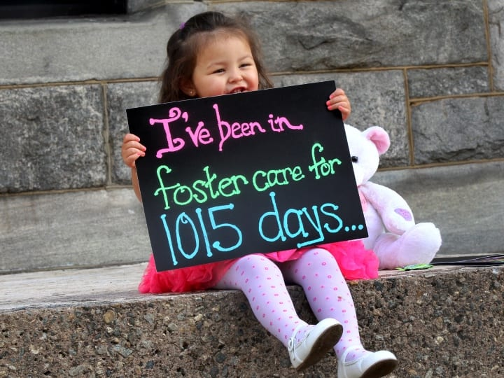 After the Rubio family formally adopted Alexandra, they pose her with a series of signs outside the courthouse. The first read: Ive been in foster care for 1015 days. The next sign she held said: But today, Sepember 21, 2015, I was adopted!
