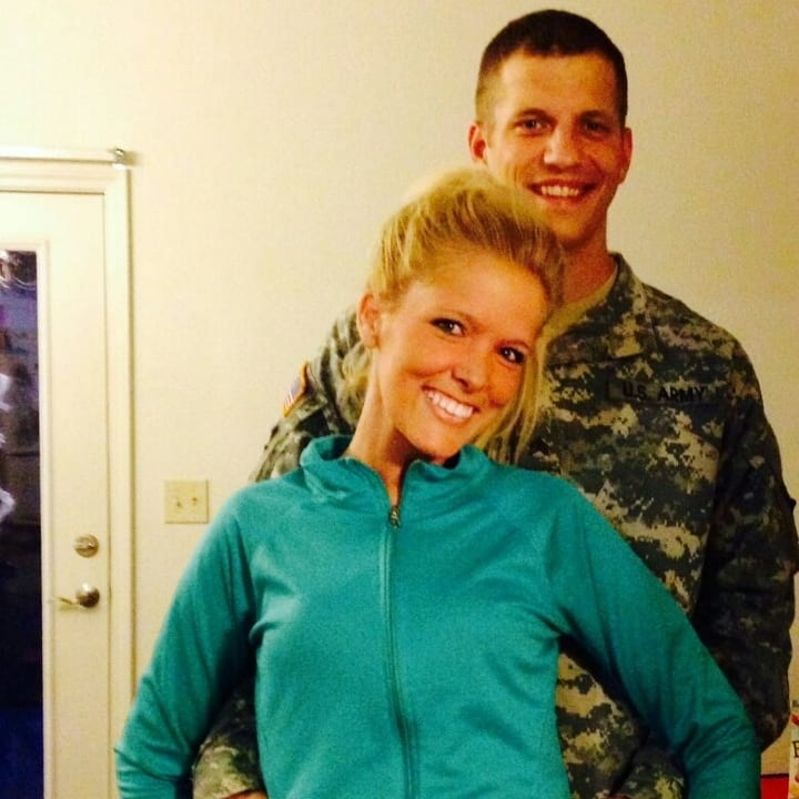 couple together, in uniform, smiling