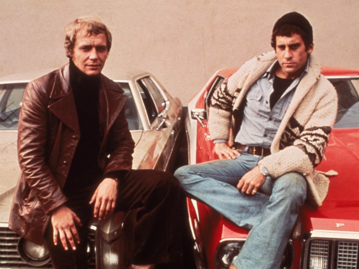 Starsky and Hutch lounging on car