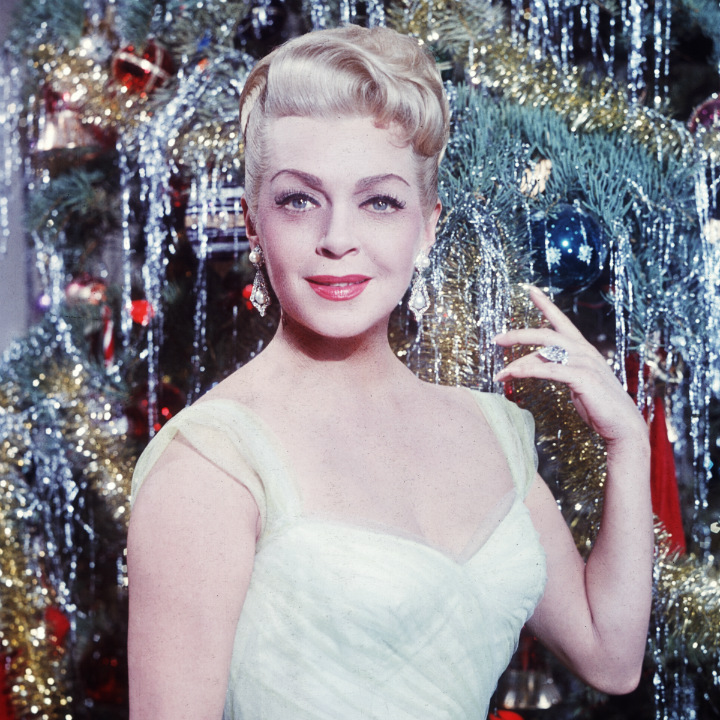 Lana Turner in front of christmas tree