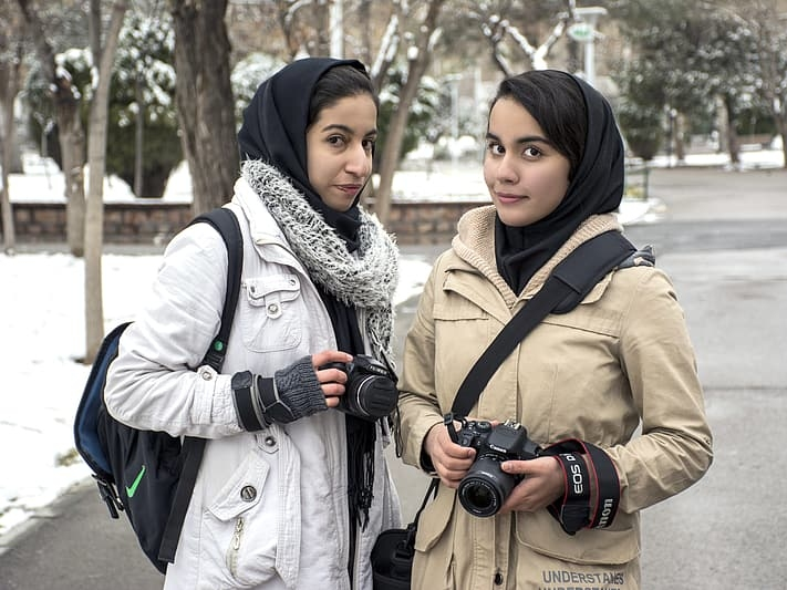 Iranian women, cold, snow in background