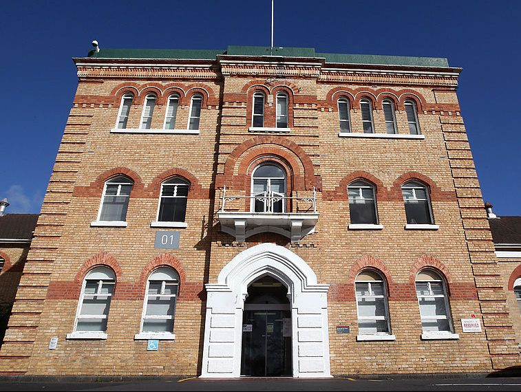 AUCKLAND, NEW ZEALAND - JUNE 18: The historic brick building in the Mt Albert grounds of Unitec on June 18, 2014 in Auckland, New Zealand. Unitec Institute of Technology has requested permission from Auckland Council to transform their historic ex-Carrington Psychiatric Hospital into heritage apartments.