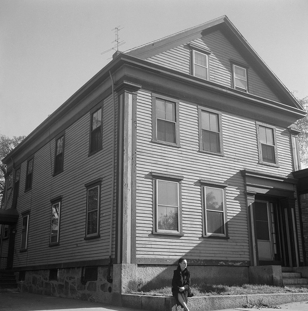 """Actress Anne Meacham sits outside the onetime home of Lizzie Borden, where in 1892, Andrew and Abby Borden were axed to death. Lizzie stood trial for the murders of her father and stepmother, but was acquitted of all charges. Meacham returns to the scene from the crime, located in Fall River, Massachusetts, in preparation for her upcoming Broadway role as Lizzie Borden in Reginald Lawrence's play, """"The Legend of Lizzie."""""""